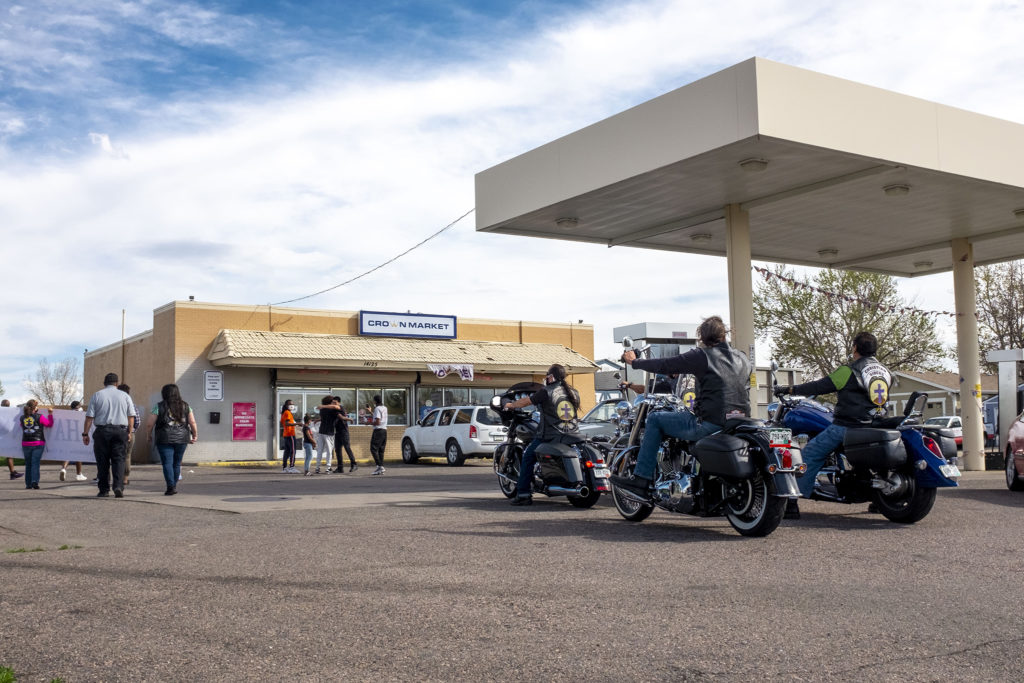 A rally against youth violence in Montbello arrives at Crown Market. May 5, 2020. (Kevin J. Beaty/Denverite)