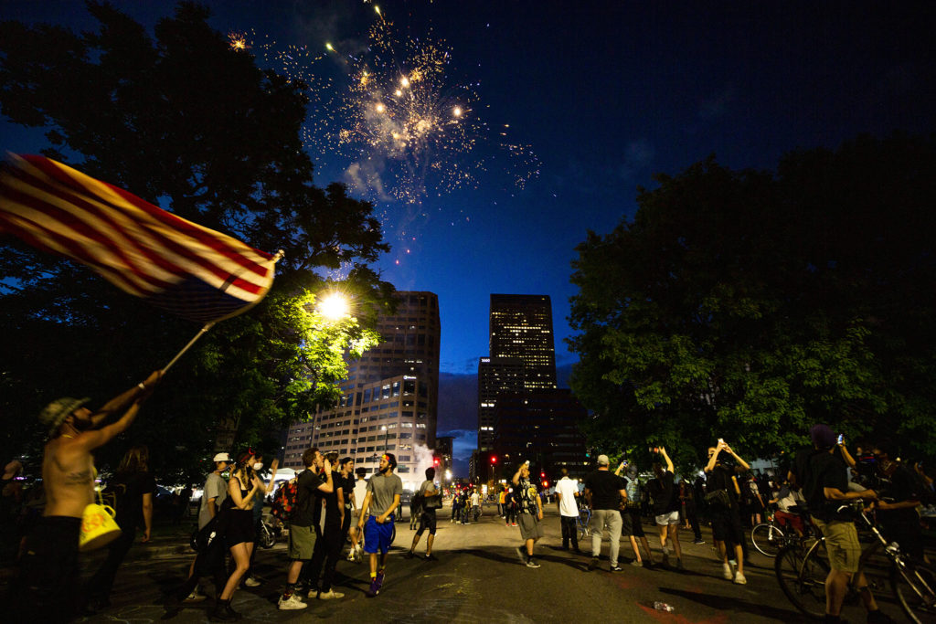 Fireworks explode over Civic Center on the sixth day of protests in reaction to the killing of George Floyd by Minneapolis police. June 2, 2020. (Kevin J. Beaty/Denverite)