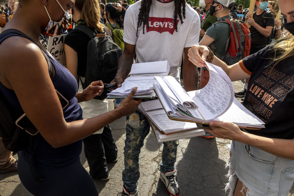 An activist distributes petitions at the Capitol on the sixth day of protests in reaction to the killing of George Floyd by Minneapolis police. June 2, 2020. (Kevin J. Beaty/Denverite)