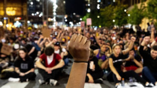 Khyra Parker raises her fist during nine minutes of silence during the sixth day of protests in reaction to the killing of George Floyd by Minneapolis police. June 2, 2020. (Kevin J. Beaty/Denverite)