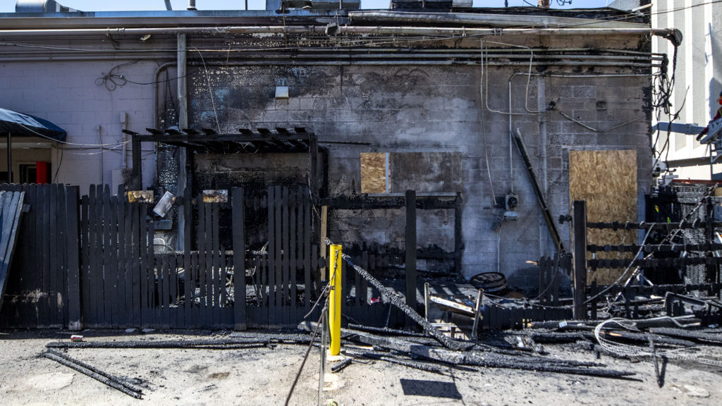City Grille's patio burned down some time between sundown on June 4 and sunup on June 5, 2020. North Capitol Hill, June 5, 2020. (Kevin J. Beaty/Denverite)
