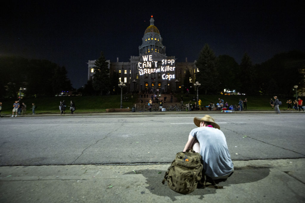"""The Capitol is emblazoned with """"We can't breathe. Stop killer cops,"""" as protests against police brutality continued on Saturday, June 7, 2020. (Kevin J. Beaty/Denverite)"""