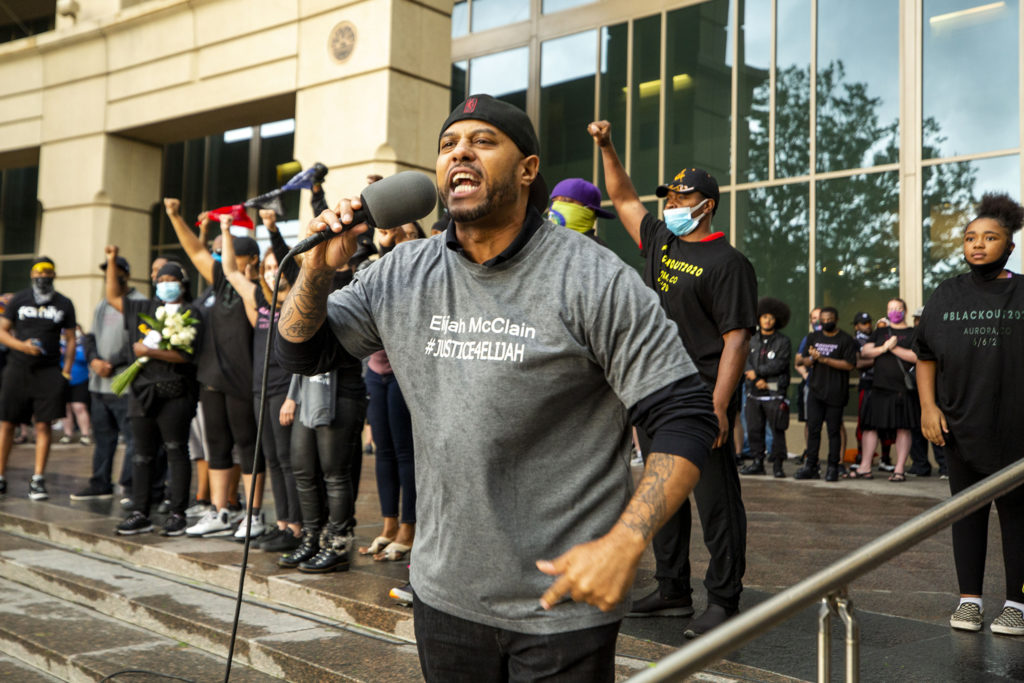 Terrance Roberts ignites the crowd with a speech during a rally against police brutality in front of the Aurora Municipal Center. June 6, 2020. (Kevin J. Beaty/Denverite)