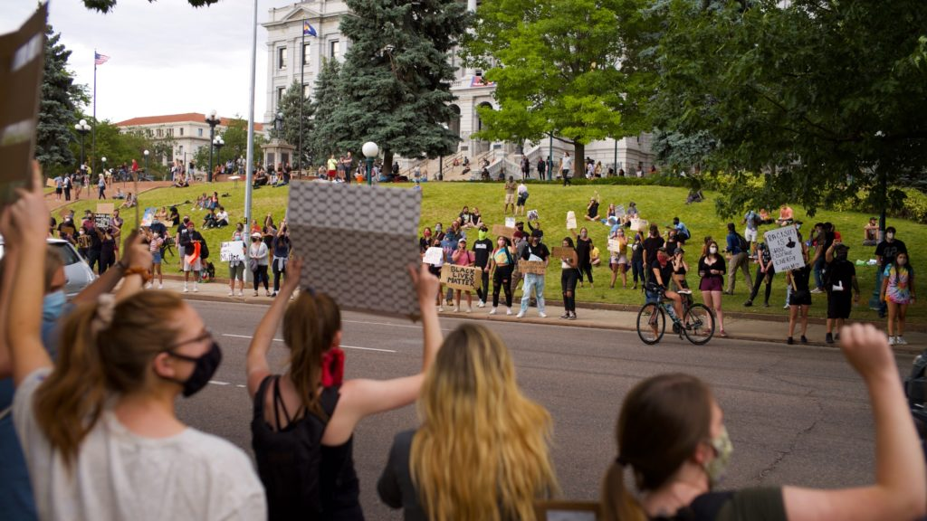 Protesters gathered in Denver for a twelfth day in a row on Monday to speak out against racism and police brutality. (Carl Glenn Payne/For Denverite)