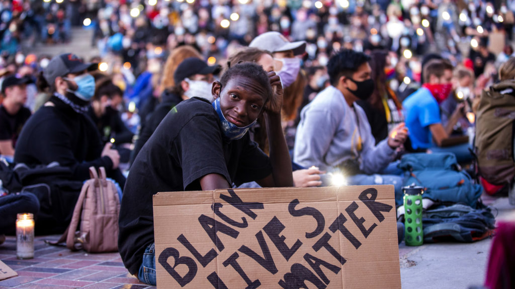 Malachi Mason holds up his protest sign during a vigil for George Floyd at Civic Center Park. June 9, 2020. (Kevin J. Beaty/Denverite)