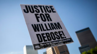 Demonstrators protest the police killing of William DeBose and other victims of police brutality Friday, June 12, 2020, at a peaceful state Capitol rally and march up Colfax int Capitol Hill.