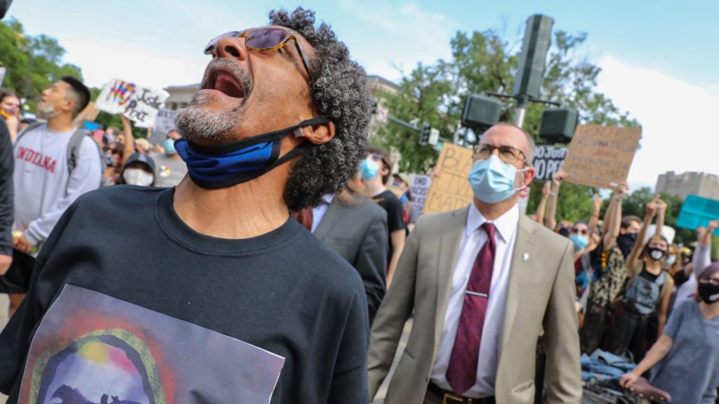 Walter DeBose shouts during a demonstration against racism and police brutality and what he insists was the murder of his son William at the hands of Denver police.