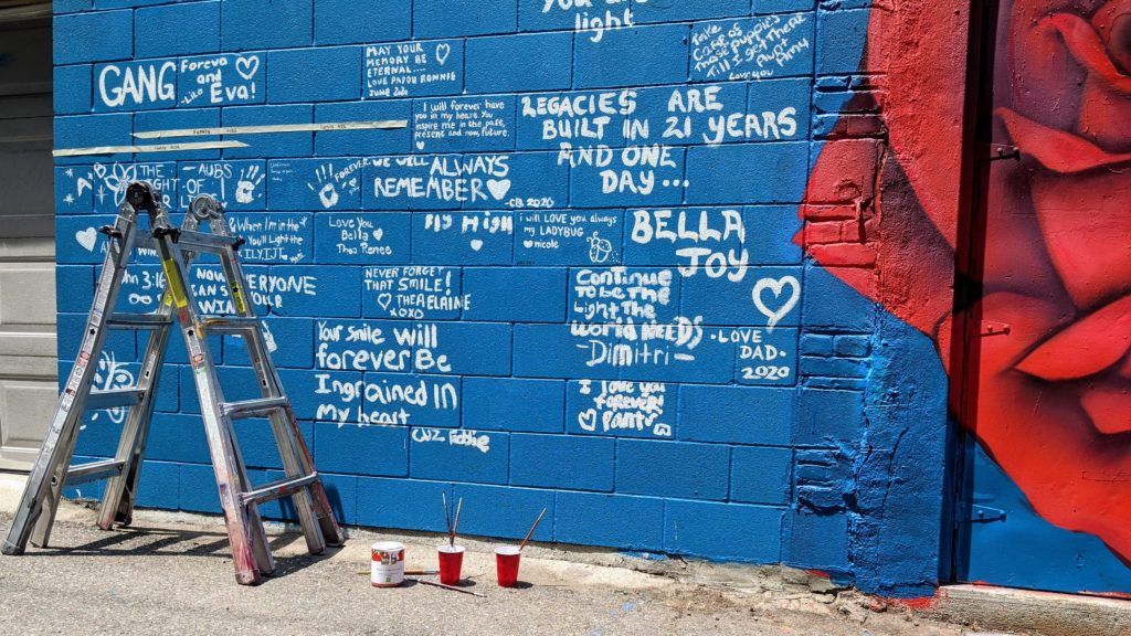 Pictured June 17, 2020 is a section of wall that muralist Thomas Evans, known as Detour, left to be filled with tributes to Isabella Thallas,  who was murdered June 10 while she and her boyfriend were walking their dog in the Ballpark section of Five Points. (Donna Bryson/Denverite)