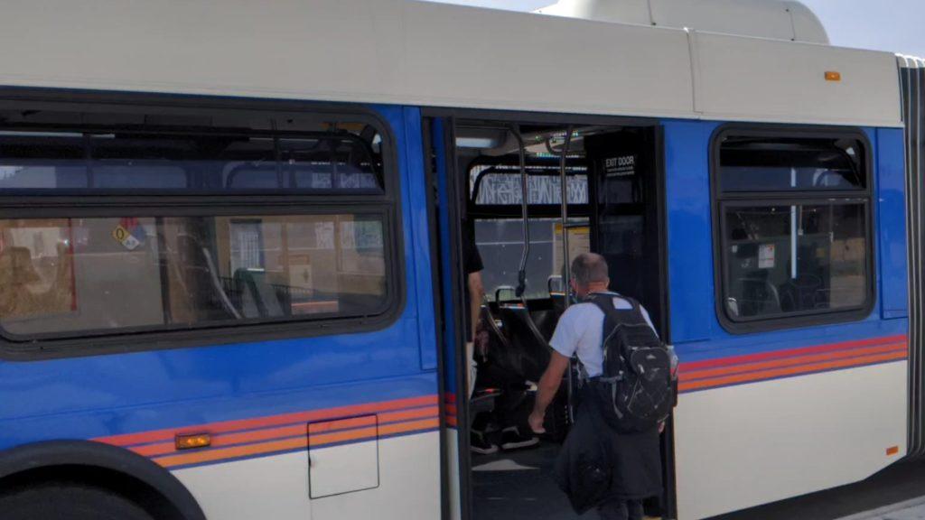 Joseph Lautrup boards a bus on June 29, 2020. (Donna Bryson/Denverite)