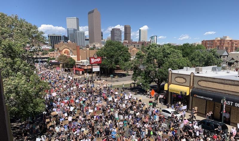 Thousands take part in a Black Lives Matter march along Colfax Avenue on Sunday, June 7, in Denver. (Esteban L. Hernandez/Denverite)