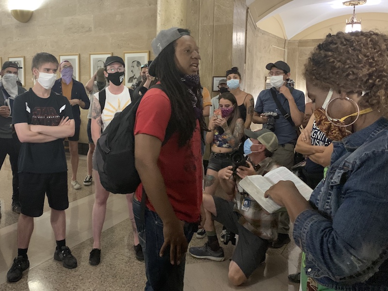 Kenny White addresses protesters after meeting with Mayor Michael Hancock on Wednesday, June 24, at the City and County Building in Denver. (Esteban L. Hernandez/Denverite)