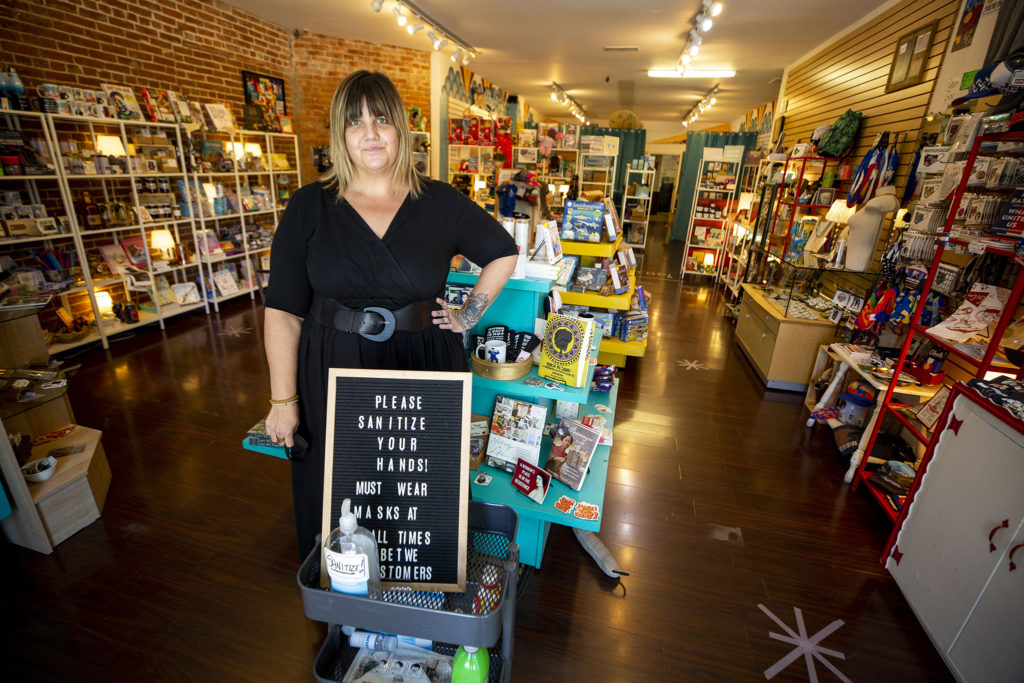 Erika Righter, owner of Hope Tank, stands in her Broadway shop. She's currently operating under limited hours. July 1, 2020. (Kevin J. Beaty/Denverite)