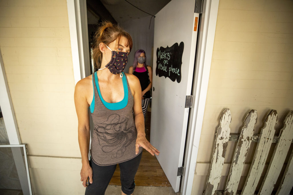Amber Blais and Staza Stone stand inside 4345 Tennyson Street, which the Rainbow Militia is turning into a performance space. Berkeley, July 2, 2020. (Kevin J. Beaty/Denverite)