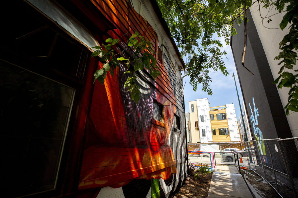 The Rainbow Militia's art house at 4345 Tennyson Street sits in between several large development projects. Berkeley, July 2, 2020. (Kevin J. Beaty/Denverite)