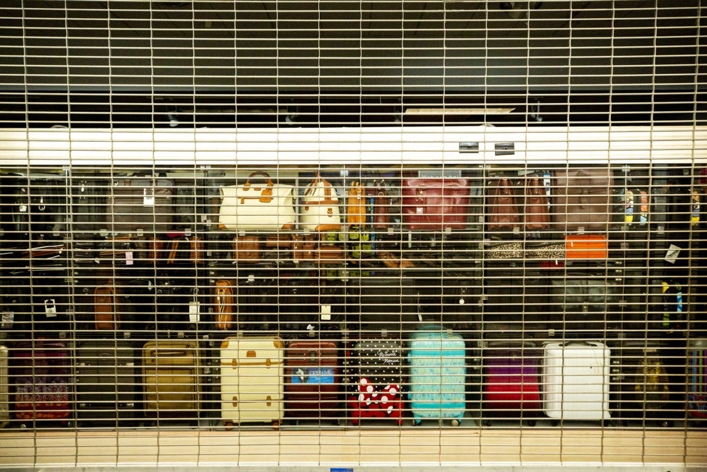 A luggage shop in Denver International Airport's terminal is closed. July 7, 2020.