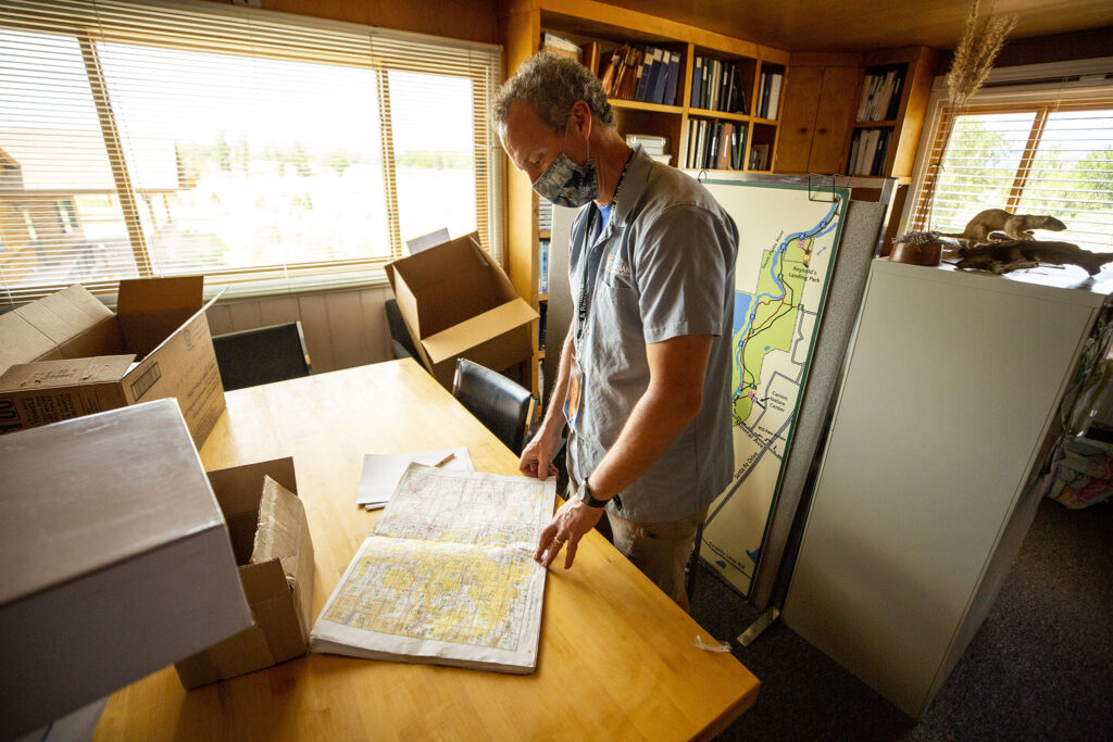 South Platte Park manager Skot Latona looks at a water systems map inside Littleton's Carson Nature Center. July 18, 2020.