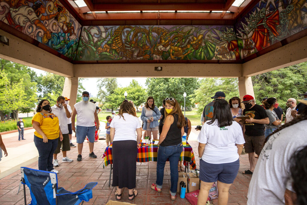 City Councilwoman Amanda Sandoval leads a signature-gatering effort to officially change the name of Columbus Park to La Raza Park. July 24, 2020.