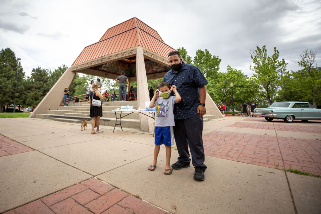 Rafael Arvizu-Derr bought his son, Rafael Jr., to a petition-signing event to change the name of Columbus Park to La Raza Park. July 24, 2020.