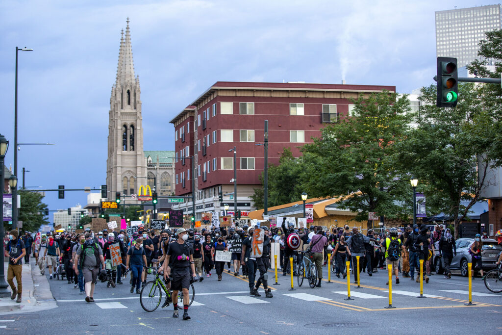 Protesters march on East Colfax Avenue to decry police brutality, racial injustice and the threat of federal agents in the metro. July 24, 2020.