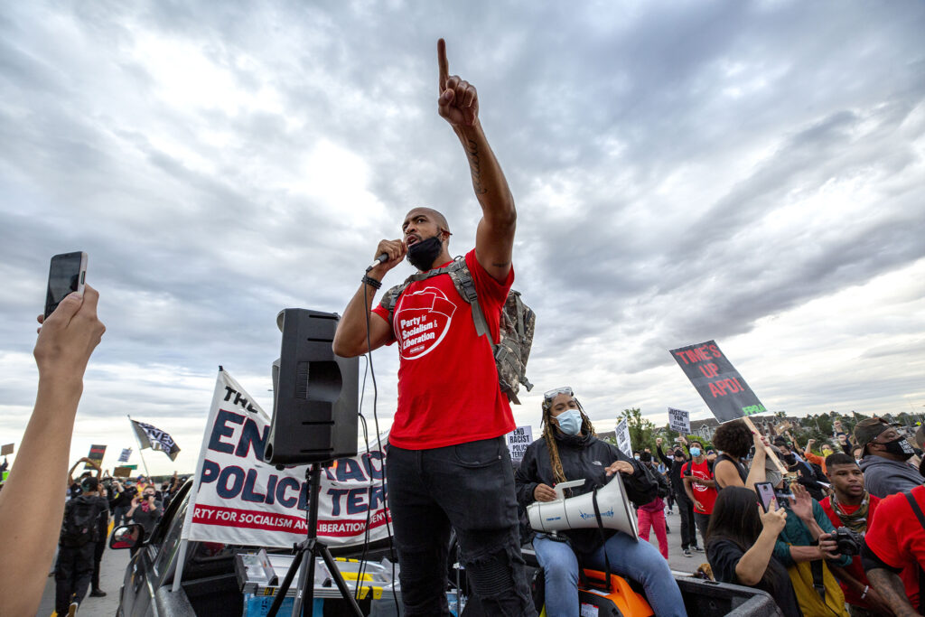 Joel Ibrahim leads a protest on I-225 demanding justice for Elijah McClain. July 25, 2020.