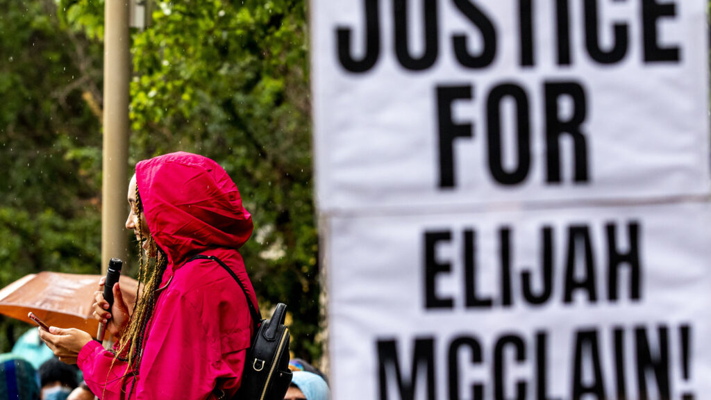 Jordan Cain leads a protest demanding justice for Elijah McClain at Aurora's municipal complex. July 25, 2020.
