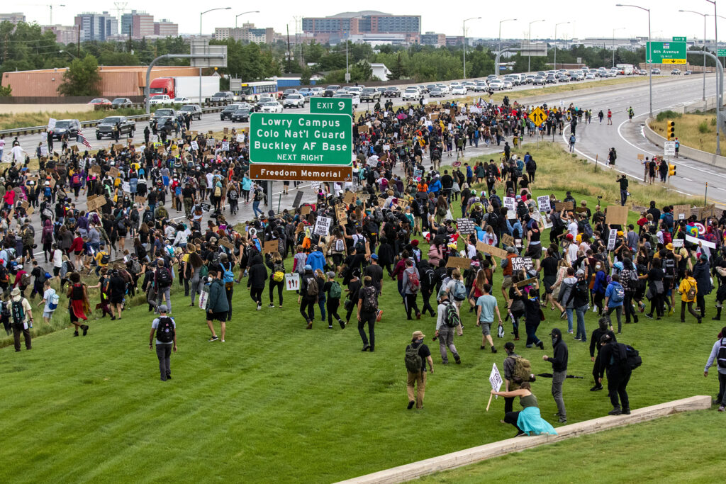 Protesters flood I-225 during an action demanding justice for Elijah McClain. July 25, 2020.
