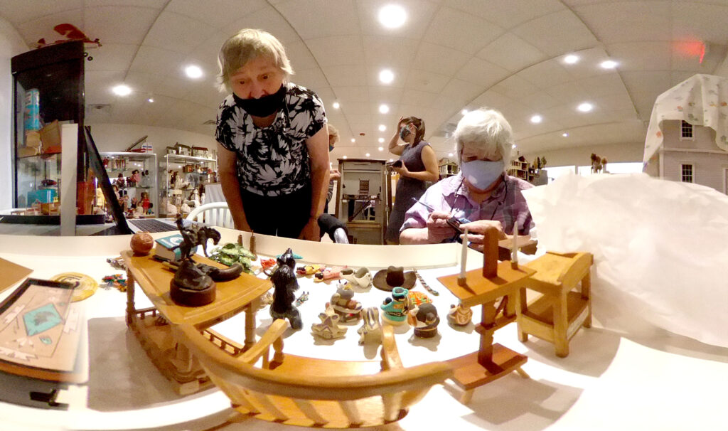 Marcia Knight and Nancy Stein work on tiny furnishings in a doll house under restoration at the Denver Museum of Miniatures, Toys and Dolls' new Lakewood location. July 28, 2020.