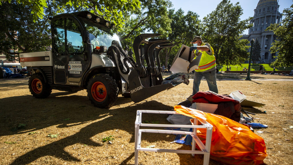 City officials conduct a forced cleanup of encampments at Lincoln Park, across Lincoln Street from the Capitol. July 29, 2020.