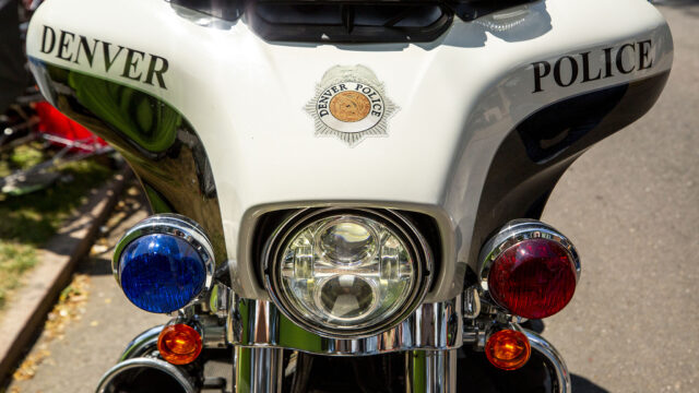 A Denver Police motorcycle parked outside of Morey Middle School in Capitol Hill. July 30, 2020.