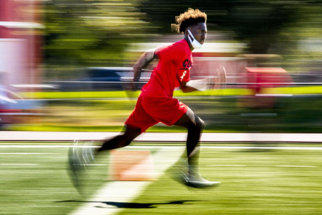 Isiah Davis, class of '22, runs drills during East High School football practice. July 31, 2020.