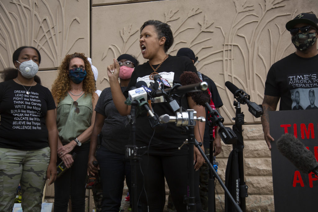 McClain family friend Candice Bailey speaks at a rally on July 3, 2020, shortly after the announcement of the officers' firings.