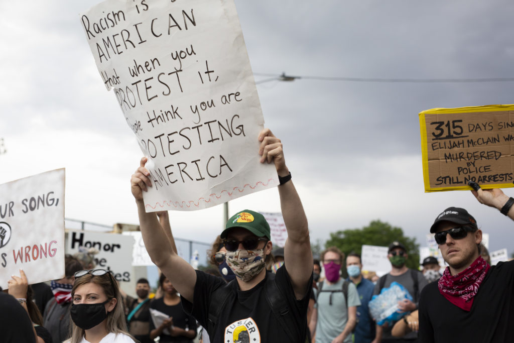 Activists at the 'Rise Up' rally in Denver on July 4, 2020