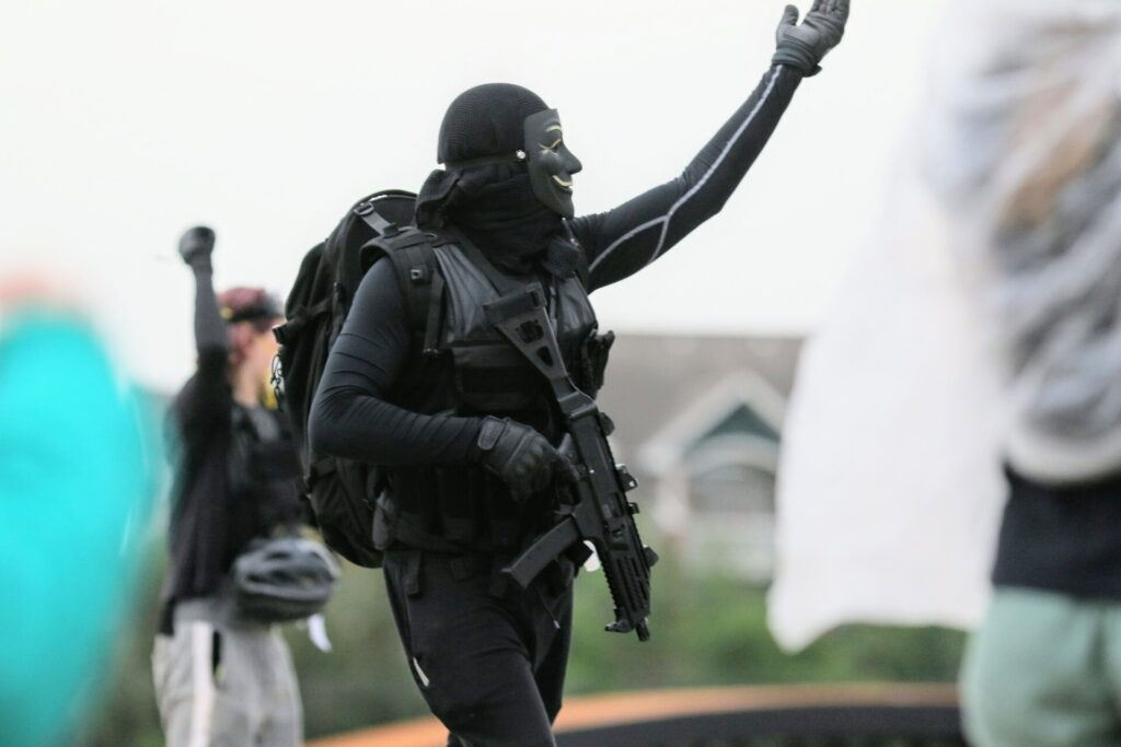 Protester with a gun in Aurora on July 25, 2020