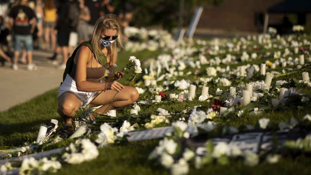 Flowers placed for Elijah McClain during a vigil in Aurora on July 11, 2020