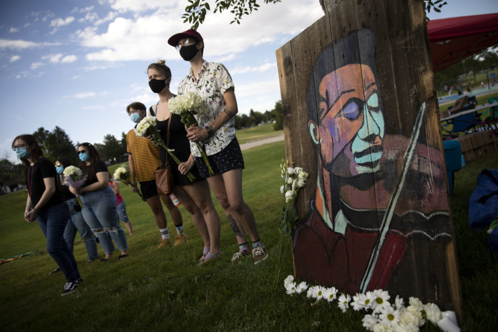 A flower and candlelight vigil for Elijah McClain in Aurora on July 11, 2020