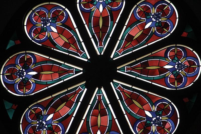 A large stain glass window inside the Howard Berkeley Park Chapel on Wednesday, July 15, 2019, in northwest Denver. (Esteban L. Hernandez/Denverite)