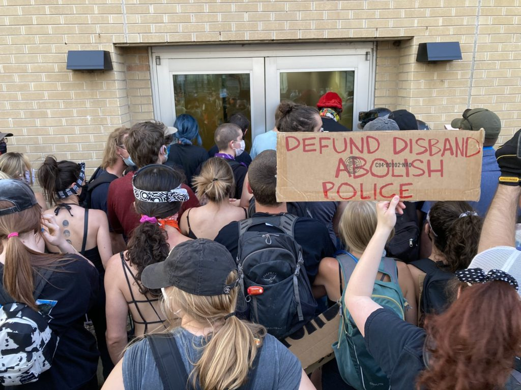 Protesters block the entrance to Aurora Police's District One building, July 3, 2020.