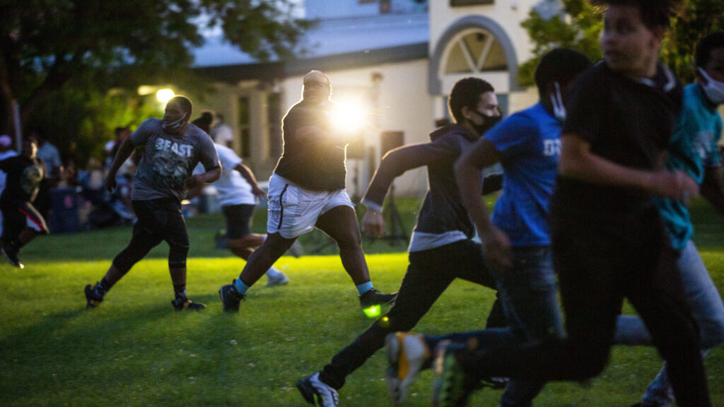 """Kids play football during a """"safe space"""" night at the St. Charles Rec Center in Cole. Aug. 8, 2020."""