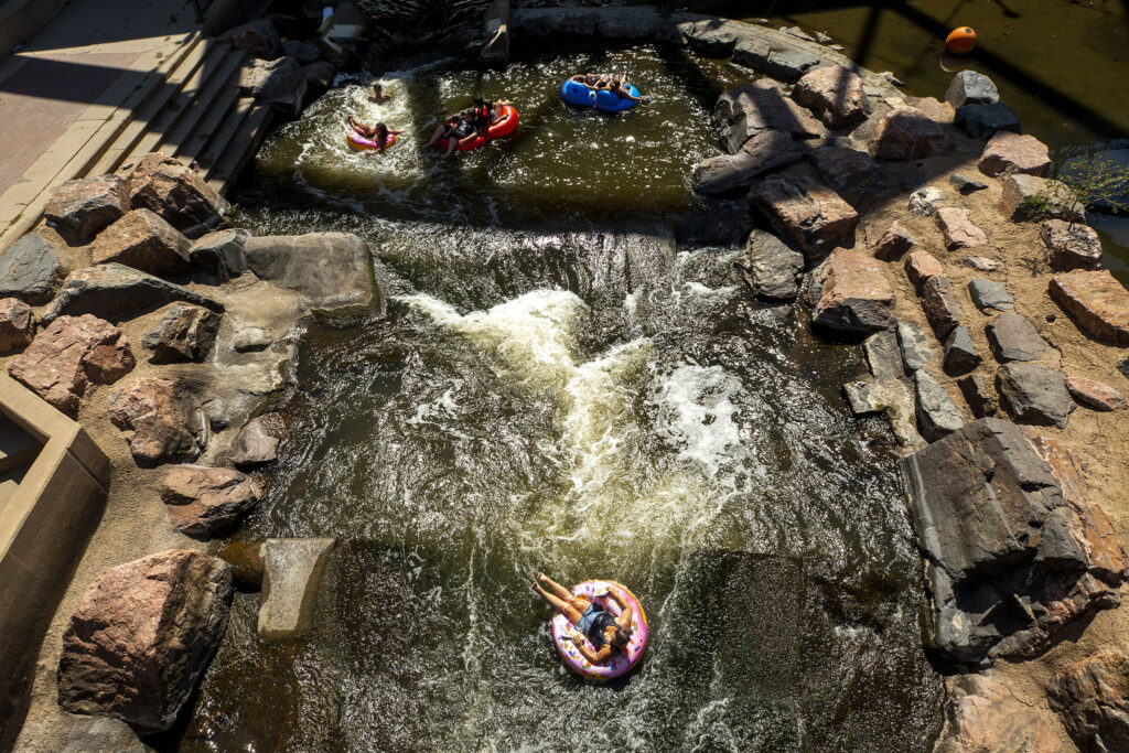 Tubes float the South Platte River into Confluence Park. Aug. 12, 2020.