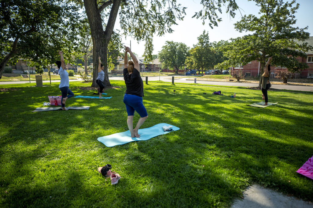 Women do yoga in Russell Square Park. Aug. 13, 2020.