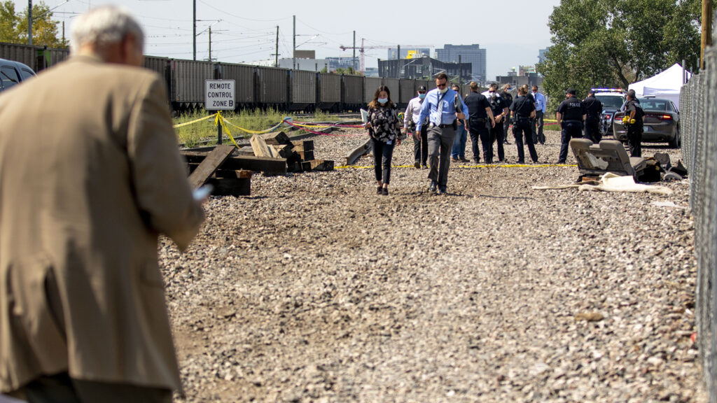 Denver police investigate an officer-involved shooting by a railway near the National Western Center. Aug. 15, 2020.