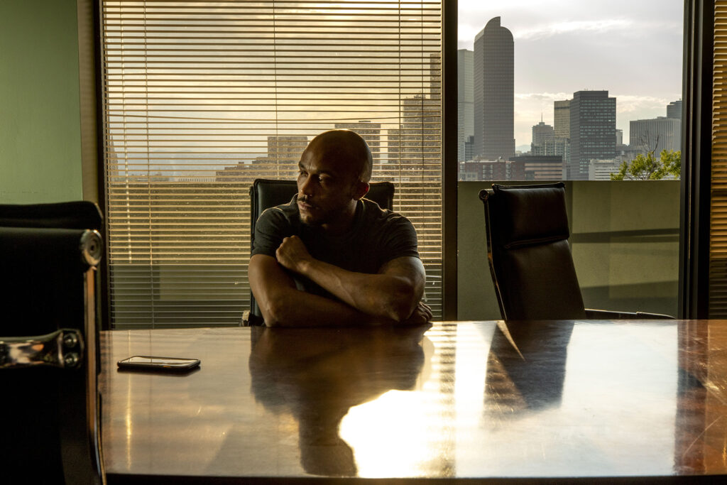 Alexander Landau sits in a conference suite above the Denver Justice Project's headquarters at 16th Avenue and Downing Street. Aug. 19, 2020.