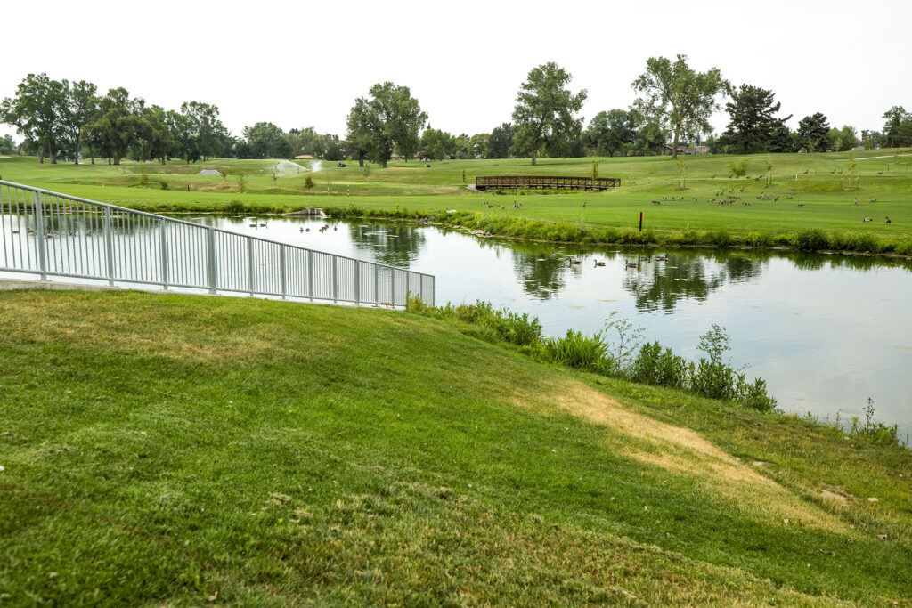 That cart bridge beyond this new detention pond at City Park Golf Course could be covered with water during a 100-year flood event. Aug. 20, 2020.
