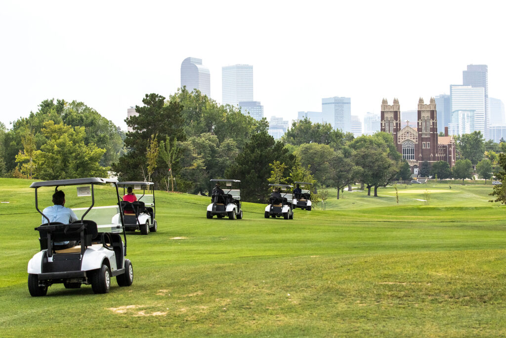A caravan of reporters tour the newly revamped City Park Golf Course. Aug. 20, 2020.