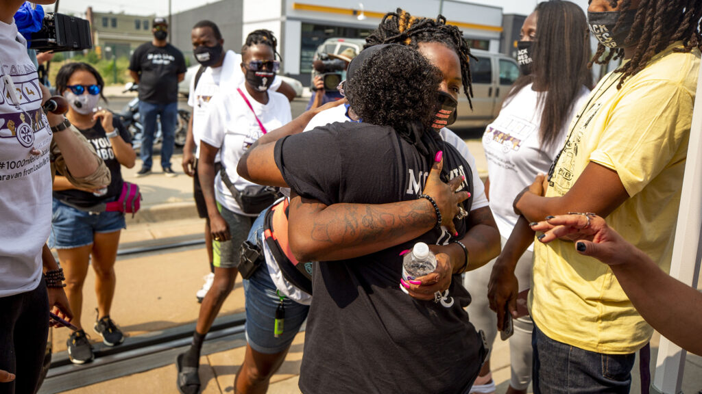 Kela Duncan, Breonna Taylor's aunt, embraces Sheneen McClain, mother to Elijah, as they meet for the first time at Brother Jeff's Cultural Center on Welton Street. Aug. 22, 2020.