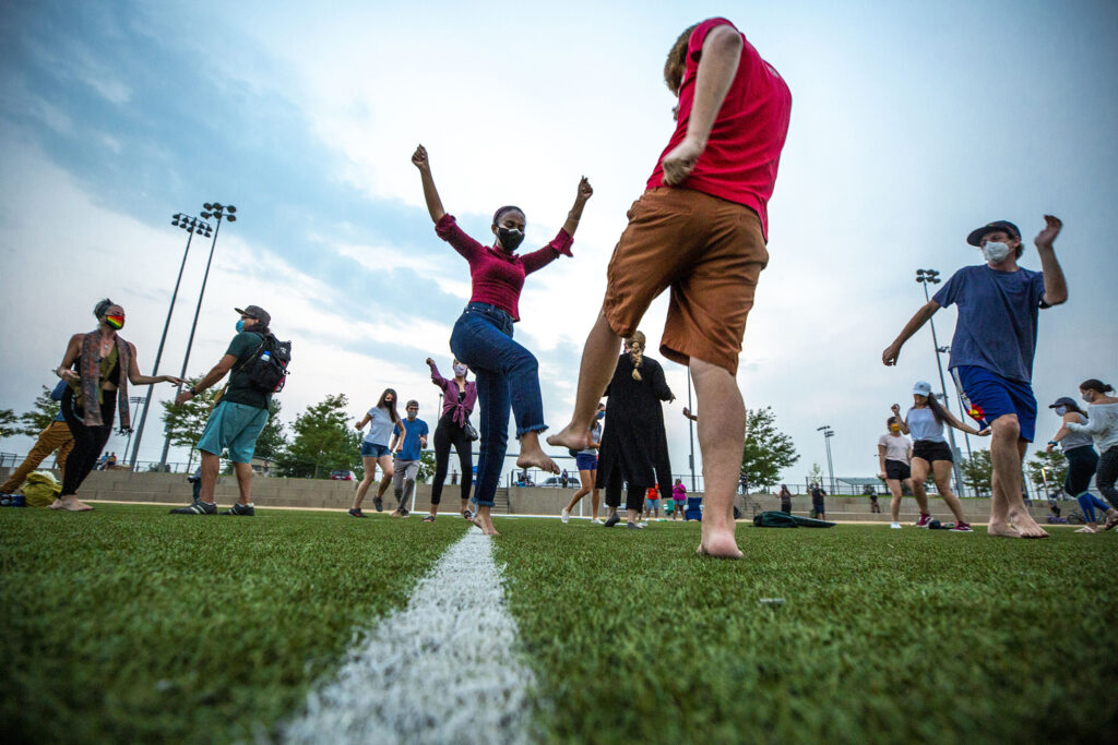 The crowd dances together during a gathering in memory of Elijah McClain at the Montbello Rec Center. Aug. 23, 2020.