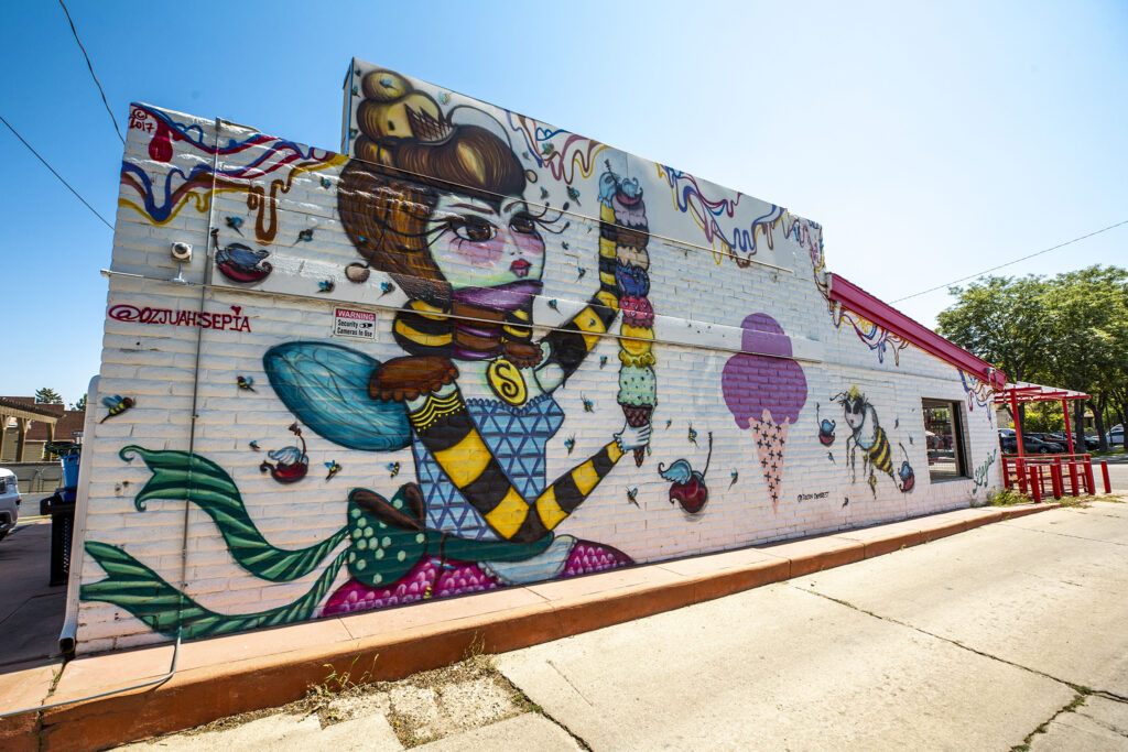 A mural by UcSepia Ozjuah on Nuggs Ice Cream on East Colfax Avenue, South Park Hill. Aug. 27, 2020.