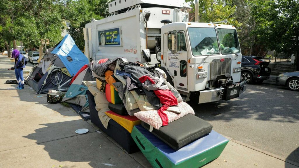 People experiencing homelessness were packing their belongings on Aug. 4, 2020 in a camp that has grown since the pandemic around a Capitol Hill middle school.