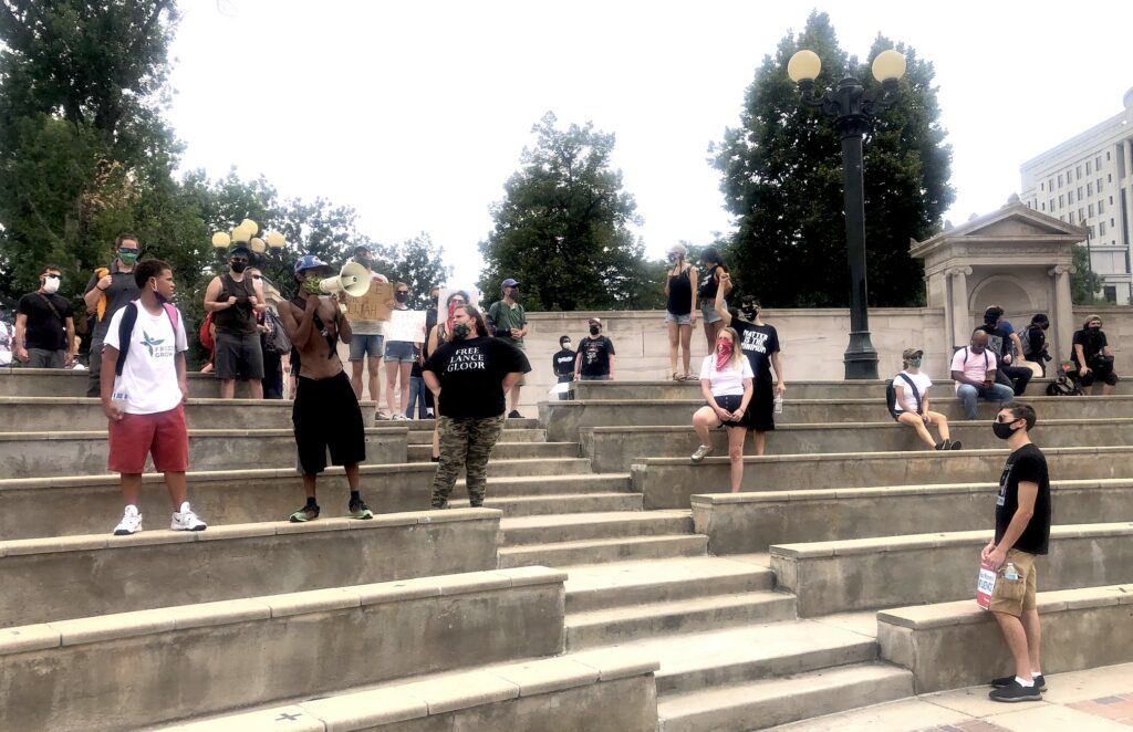 Protesters chant at the Greek Theater during protests against racism on August 28, 2020.