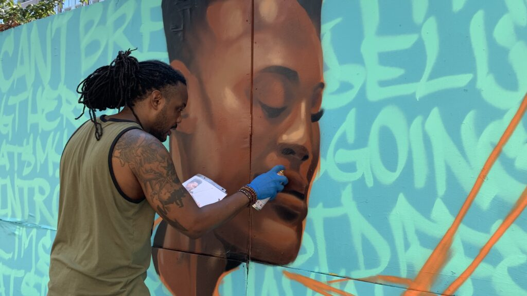 Vince Ballentine painting a mural of Elijah McClain in New York City. Photo by Carmelo Nieves.